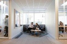 Business People Meeting And Working In Highrise Office