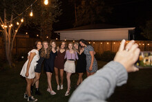 Teenage Girl Friends Posing For Photo In Backyard At Night