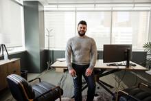 Portrait Handsome Businessman In Highrise Office