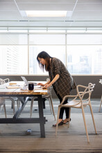 Businesswoman Working At Laptop On Table In Coworking Space Office