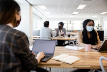 Business People In Face Masks Working In Coworking Space