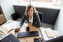 Businesswoman Working At Computer At Office Desk