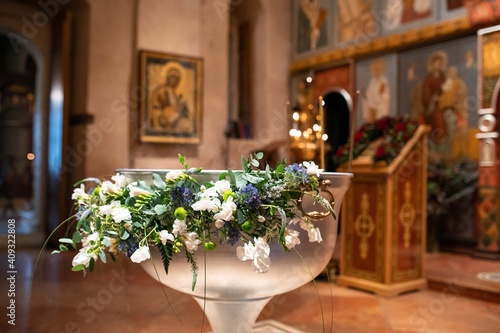Fotografija Baptismal font decorated with flowers