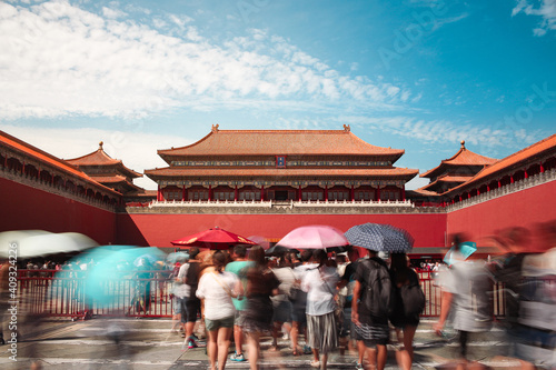 Tableau sur Toile Long exposure shot of entrance to the Forbidden city, UNESCO heritage site and crowd of tourist in Beijing, China