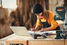 Artisan Woman Working In Carpentry Workshop