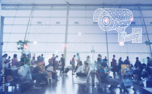 Obraz Security technology concept. Virtual modern CCTV camera on a wall,  people in the airport with iot machine learning - fototapety do salonu