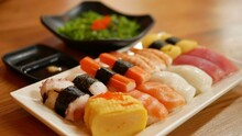Nigiri Sushi Set And Seaweed Salad On Side (Salmon, Tuna, Shrimp, Calamari, Squid, Sweet Egg, Imitation Crab)