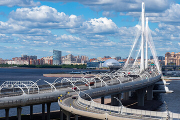 Summer in Saint Petersburg. Russia road. Big bridge in Saint Petersburg. Panorama of Petersburg from quadcopter. Russian city on sunny day. Top view of automobile bridge. Road architecture in Russia