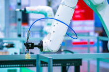 Industrial Robot. Robotics. Production Automation. Programming Devices For Use In The Factory Floor. The White Arm Of A Robotic Arm. Machines Replace People In Production.