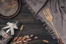 Flat Lay, Wooden Plate On A Wooden Background, Bottle, Fork, Branches. Rustic Background, Style. The Concept Of A Cafe, Restaurant. Food