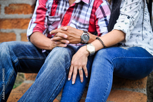 Obraz Closeup shot of a loving couple sitting close outdoors enjoying time together - fototapety do salonu