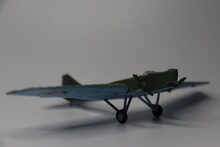 Model Of An Old Green Military Aircraft From The Second World War On A White Background. Aeromodelling. Hobby And Collection.