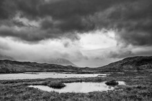 Epic Dramatic  Black And White Landscape Image Of Loch Ba On Rannoch Moor In Scottish Highlands On A Winter Morning