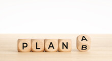 Wooden Cube Blocks With PLAN A Change To PLAN B Text On Table. Copy Space