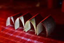 Brown Wooden Objects On Red Surface