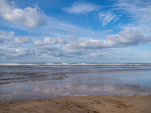 Beautiful Empty Beach With Tide Coming In, Blue Sky In Winter, UK.