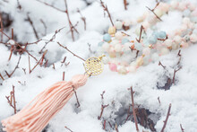 Brass Metal Spiritual Symbol Of Yantra Faceted Morganite Mala Necklace On The White Snow