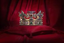 Golden Crown On Red Velvet Background Royal Symbol, Coronation.