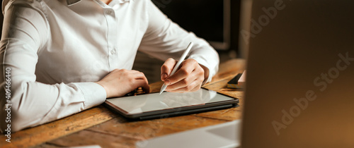 Obraz Male hands drawing on digital tablet with electronic pen. Freelancer designer working remotely. Close-up photo - fototapety do salonu