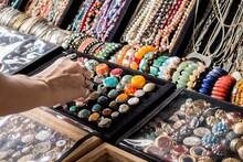 Tropical Look A Like Rings, Bracelets, Earrings Getting Picked By A Female Hand.