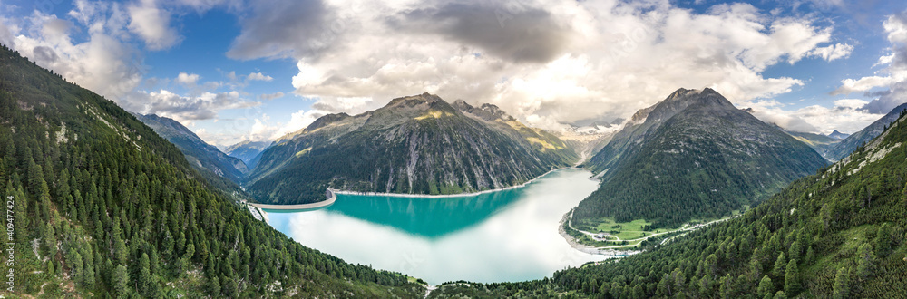 Fototapeta Aerial panorama drone shot of Schlegeisspeicher resevoir with galcier view at dusk