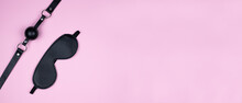A Variety Of Sex Toys (eye Mask, Harness, Gag In The Mouth) Are Presented On A Pink Background. The Image Is Suitable For Advertising And Promoting A Sex Shop. Banner