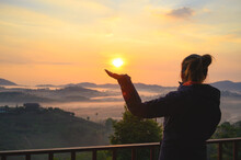 Asian Woman Enjoys The View Of Misty Landscape In Morning At Khao Kho Hill In Phetchabun, Thailand