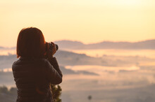 Asian Female Photographing Misty Landscape In Morning Spend Vacation In Khao Kho Hill Thailand