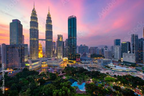 Obraz na plátně Kuala Lumpur skyline financial downtown district and KLCC park view at sunset