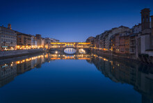 Ponte Vecchio Bridge And Arno River In Florence At Sunset. Tuscany, Italy.