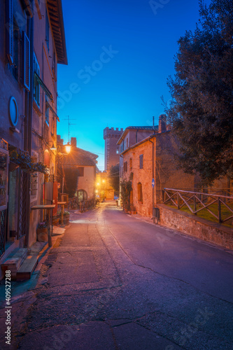 Bolgheri medieval village street at sunset. Castagneto Carducci, Tuscany, Italy