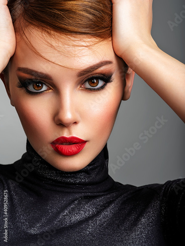 Obraz na plátně Beautiful girl with red lips and short hair