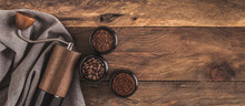 Manual Coffee Grinder And Jars Of Fresh Ground Coffee From Roasted Beans On Wooden Rustic Table. Banner.