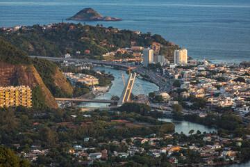 Aerial view of Barra da Tijuca main street Avenida das Americas with cars and famous bridge