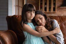 Close Up Caring Little Girl Comforting, Hugging Depressed Mother, Sitting On Couch At Home, Preschool Daughter Calming, Embracing Upset Frustrated Mum, Family Overcoming Problems Together, Divorce
