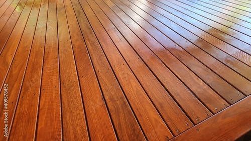 Fotografering Freshly oiled Australian Spotted Gum Timber Deck for home entertainment area