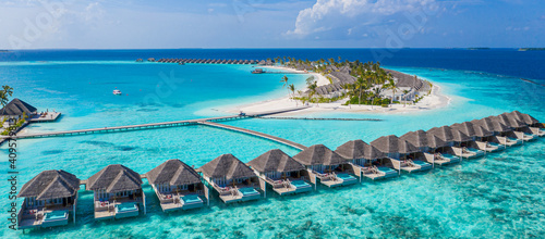 Cuadros en Lienzo Aerial view of Maldives island, luxury water villas resort and wooden pier