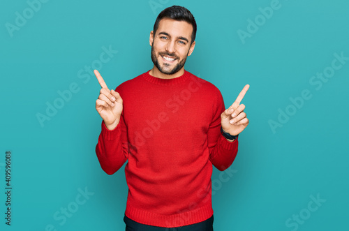 Fotografija Young hispanic man wearing casual clothes smiling confident pointing with fingers to different directions