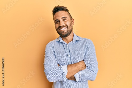 Papel de parede Handsome man with beard wearing casual clothes happy face smiling with crossed arms looking at the camera