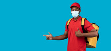 African American Delivery Man In Mask Pointing At Copy Space