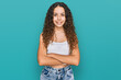 Leinwandbild Motiv Teenager hispanic girl wearing casual clothes happy face smiling with crossed arms looking at the camera. positive person.