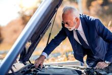 Senior Man Check Oil