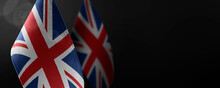 Small National Flags Of The United Kingdom On A Dark Background