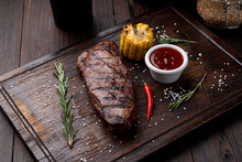 Tenderloin Steak With No Side Dish On A Dark Wooden Board