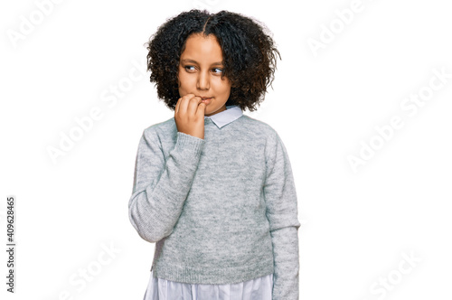 Young little girl with afro hair wearing casual clothes looking stressed and nervous with hands on mouth biting nails Fototapeta