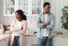 Relationship Crisis. Offended Young African American Spouses Standing In Kitchen After Quarrel
