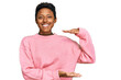 canvas print picture - Young african american woman wearing casual clothes gesturing with hands showing big and large size sign, measure symbol. smiling looking at the camera. measuring concept.