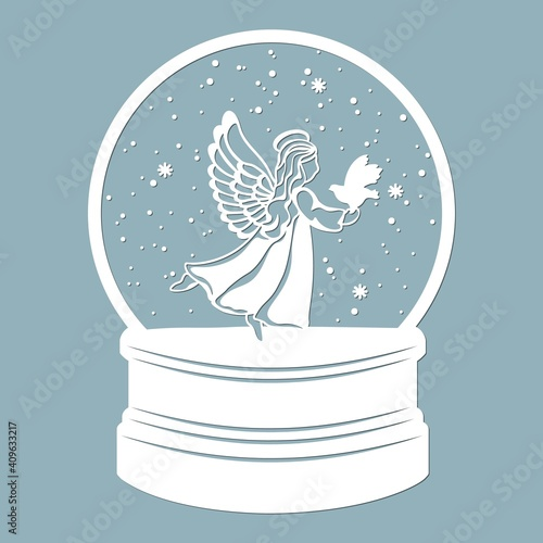 Photo A snow globe, an angel with wings