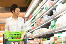 Black Woman Doing Grocery Shopping In Supermarket Buying Food