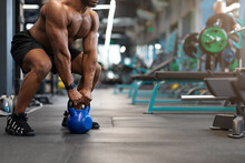 Cropped Of Black Muscular Man Working Out With Kettlebell
